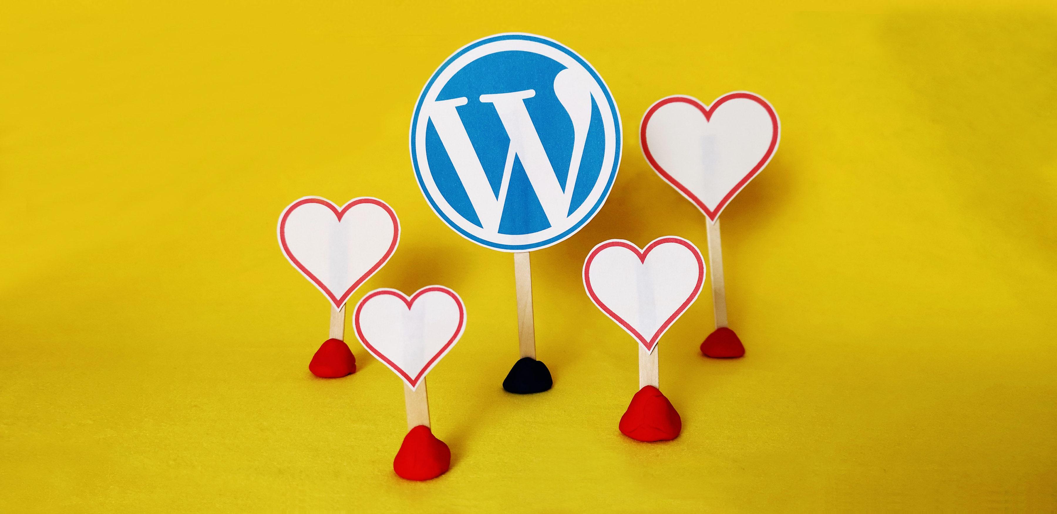 Wordpress logo with hearts around it