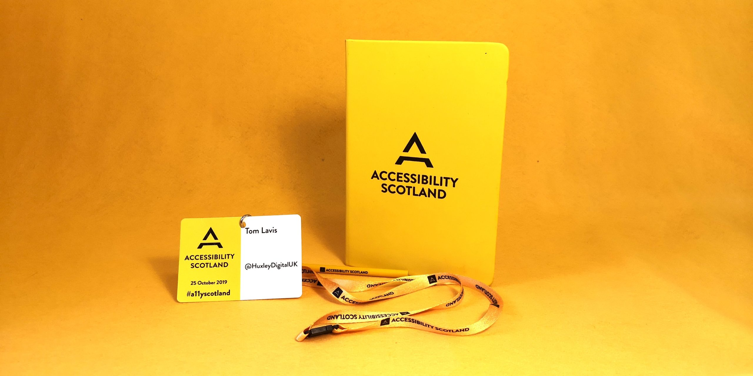 Our passes and some swag from the Accessibility Scotland conference