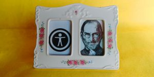 steve jobs and the accessibility logo in a frame