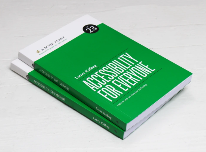 2 copies of Accessibility for Everyone laying on a white surface; They have a green cover and simple white text.