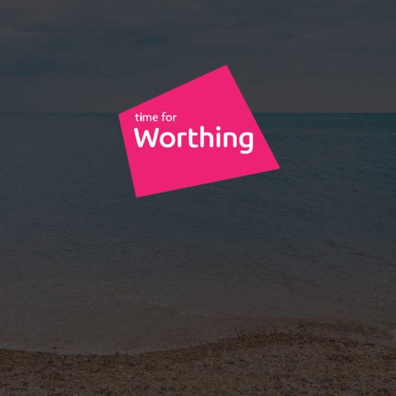Time for Worthing logo superimposed on a photo of an emoty Worthing beach shoreline and horizon - darkened